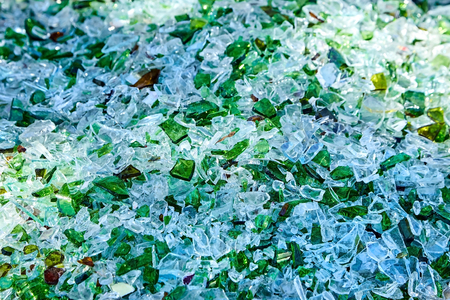Shards of broken glass bottles. Recycling. Abstract background