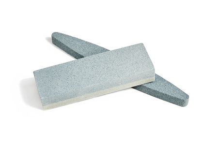 Two Sharpening stones. Grindstone or whetstone sharpener, isolated on white background. Kitchen utensils