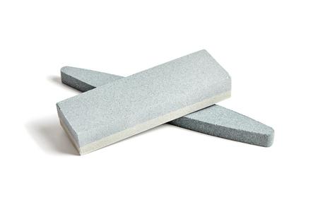 Two Sharpening stones. Grindstone or whetstone sharpener, isolated on white background. Kitchen utensils