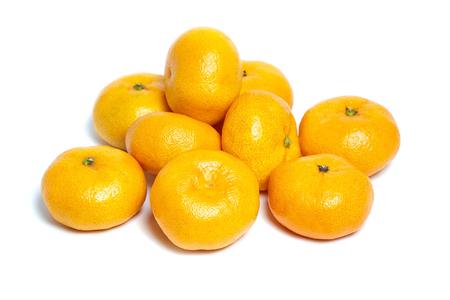 Heap tangerine or mandarin citrus fruit isolated on white background