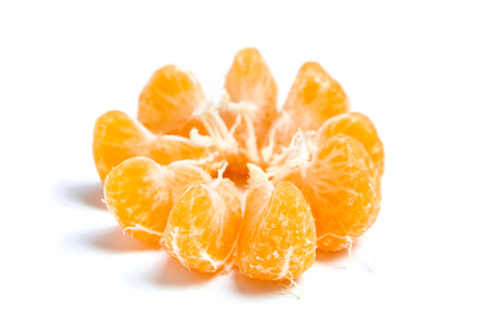 Peeled segments of tangerine or mandarin citrus fruit isolated on white background