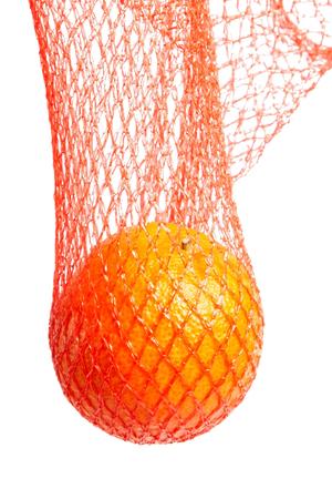 Mandarin, tangerine citrus fruit in red net isolated on white background