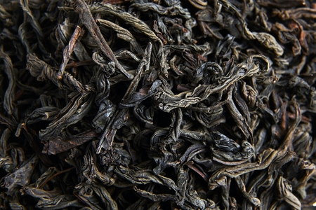 Black tea loose dried leaves. Background Stock Photo