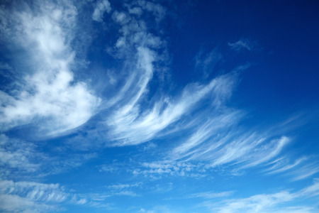 amazing white clouds of unusual shape on blue sky background Foto de archivo