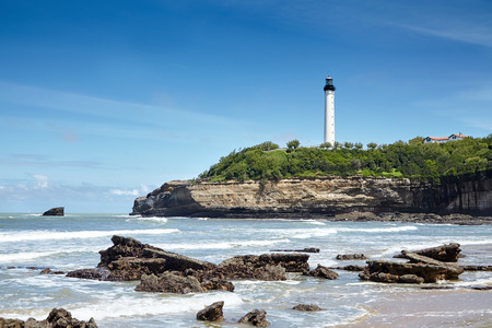 Biarritz, France. White lighthouse - Phare de Biarritz. Rocky shore of the ocean. Bay of Biscay, Atlantic coast Stock Photo