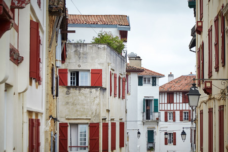 Traditional red and white half-timbered basque houses, typical architectureof Saint Jean de Luz, Pyrenees-Atlantiques department in south-western France