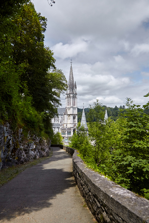 Lourdes, France: The Sanctuary of Our Lady of Lourdes is one of the largest pilgrimage centers in Europe. Upper Basilica and Way of the Cross on the Hill