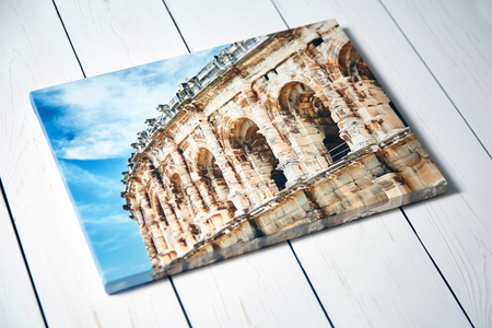 Canvas print. Photo with gallery wrap method of canvas stretching on stretcher bar. Photography with image of the ancient Roman amphitheatre in Nimes city, France Фото со стока