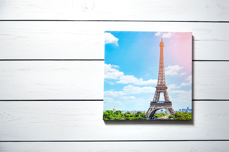 Canvas print. Photo with gallery wrap method of canvas stretching on stretcher bar. Photography with image of  The Eiffel Tower (Paris, France) hanging on a white wooden wall Stockfoto