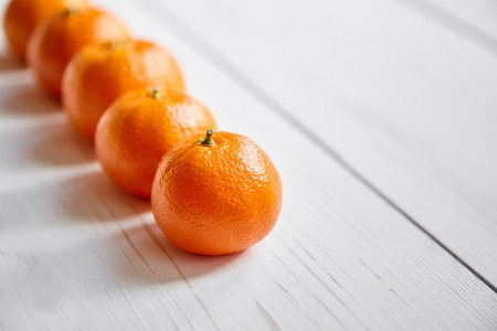 Tangerine fruits on a white wooden table Stock Photo