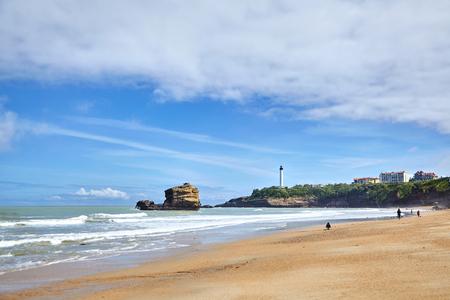 Biarritz, France. Sandy beach and white lighthouse - Phare de Biarritz. Resort city on french Atlantic ocean coast