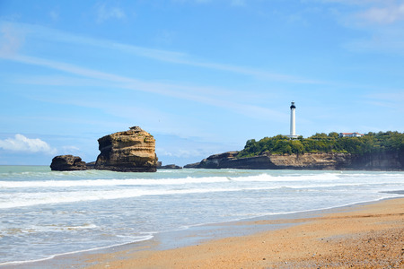 Sandy ocean beach and white lighthouse, located in Biarritz, France Stock Photo - 124236828