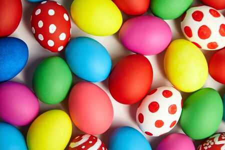 Colorful painted Easter eggs background. Christian holiday traditions. Traditional symbol. Ceremonial food. Top view