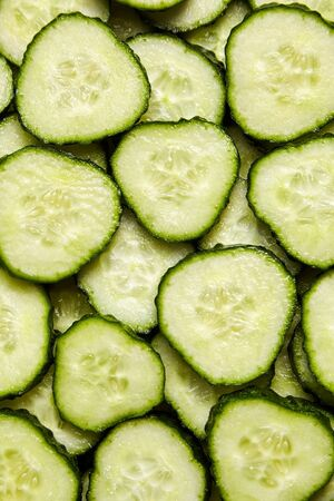 Fresh green slices of cucumber as background Stock Photo