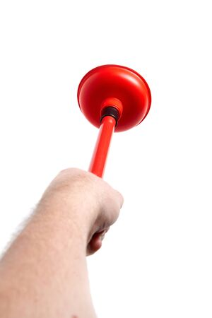 Hand holds a rubber plunger with red handle, isolated on white background. Tool for cleaning drain clogs