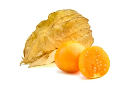Physalis peruviana berries, ripe fruit cut in half, whole and halved goldenberries with dry leaves (groundcherries, Cape gooseberry, husk tomatoes) isolated on a white background