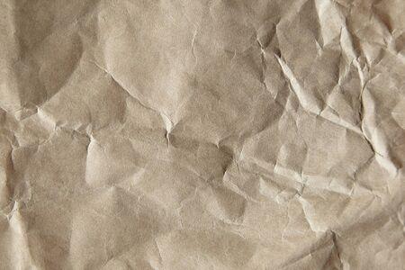 Paper texture background. Tan crumpled craft paper surface, closeup Foto de archivo