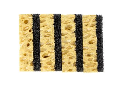 Household sponges from reticulated foam isolated on white background. Yellow black sponges for washing dishes