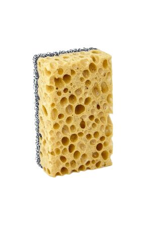 Household sponge from reticulated foam isolated on white background. Single yellow black sponge for washing dishes