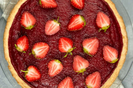 Strawberry pie with fresh berries topping. Summer dessert, top view.