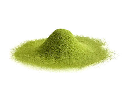 Freeze dried wheatgrass powder heap isolated on white background. Detox superfood. Vegan-friendly supplement.