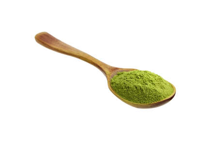 Organic wheatgrass powder in wooden spoon isolated on white background. Alternative medicine, herbal nutritional supplement.