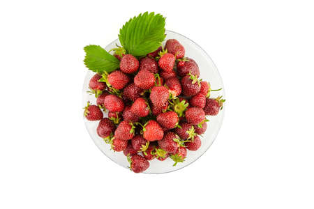 Strawberries on a transparent glass plate isolated on white background. Red ripe berries, fresh juicy strawberries, top view