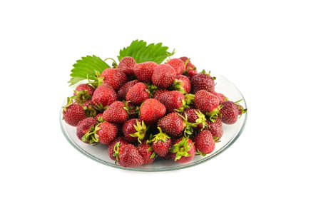Strawberries on a transparent glass plate isolated on white background. Red ripe berries, fresh juicy strawberries Standard-Bild