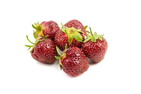 Strawberries isolated on white background. Fresh red ripe berries, heap of juicy strawberries