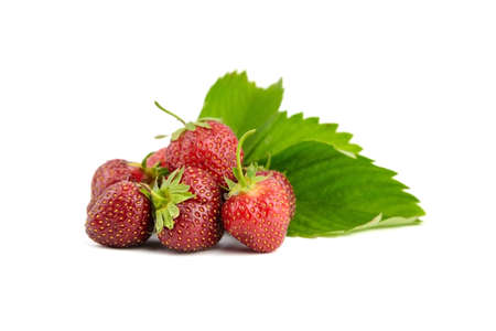 Strawberries with green leaves isolated on white background. Red ripe berries, heap of fresh juicy strawberry