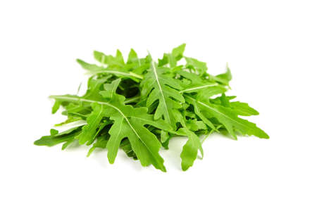 Heap of green fresh arugula or rucola salad leaves isolated on white background