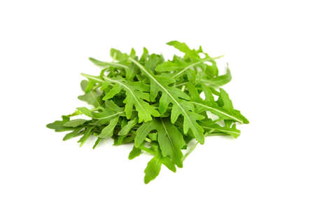 Green fresh rucola or arugula leaves isolated on white background. Vegan healthy food concept.