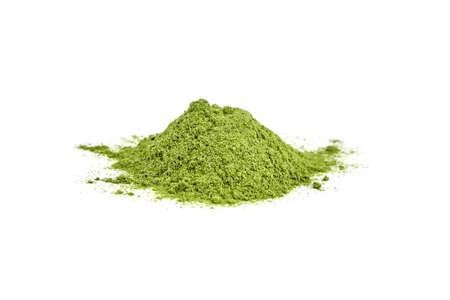 Dried organic wheatgrass powder heap isolated on white background.