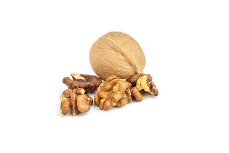 Walnut fruits, whole and kernels isolated on white background