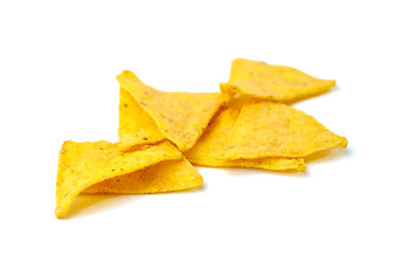 nachos, corn chips, snack isolated on white background. Scattered fast food, suitable for vegetarians. Traditional mexican food. Selective focus