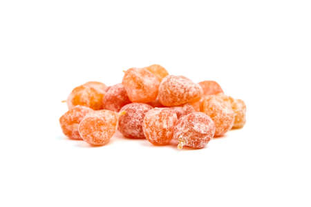 Candied kumquats, heap of dried fruits isolated on white background. Sugar coated kumquats