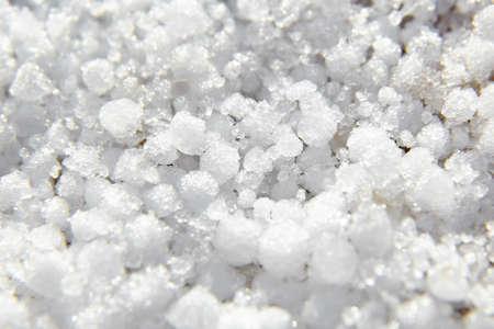 Graupel, snow pellets or soft hail texture, background, macro. Form of precipitation. Graupel has shape of small white balls, closeup, selective focus 版權商用圖片