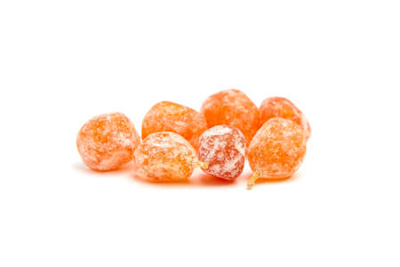 Candied fruits, heap of dried kumquats isolated on white background. Sugar coated kumquats