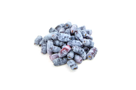 Honeyberry (Lonicera caerulea) sweet berries isolated on white background. Heap of sweetberry honeysuckle (Haskap berry) Standard-Bild