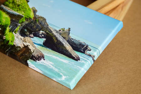 Photo canvas print mounted with gallery wrap and stacked stretcher bars on fiberboard table. Landscape photo printed on canvas. Photography with image of Atlantic ocean coast Standard-Bild