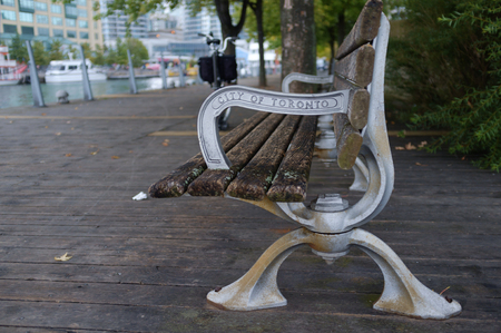 City of Toronto embossed on the arm rest of a public bench Banco de Imagens