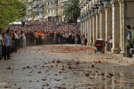 holy jug: CORFU, GREECE - APRIL 18, 2009: At 11:00am on Holy Saturday, as is customary, Corfians throw water filled jugs and pots from balconies at the Liston Spaniada promenade on Holy Saturday, to celebrate the Resurrection. Editorial