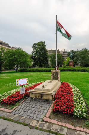 soviet flag: 1956 revolt Memorial grave and Hungarian flag with a hole where the Soviet coat of arms used to be.