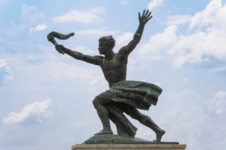 triumphant: Statue of a torch bearer representing progress Stock Photo