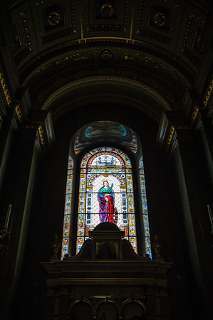 saint stephen cathedral: One of the stained glass windows of Saint Stephen cathedral in Budapest, viewed from inside