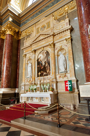 patron: The Patrona Hungariae Altar by Gyula Benczur depicts St. Stephen offering the Hungarian Crown to the Virgin Mary asking her to be a patron of Hungary. Editorial