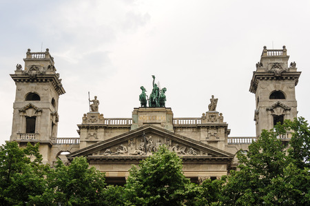 sculptural: Apex, towers, metope panel and The Spirit of Enlightenment sculptural composition on top of the Ethnographic Museum in Budapest Editorial