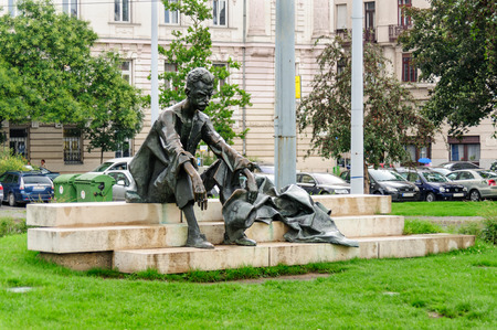 poet: BUDAPEST, HUNGARY - JUNE 29, 2009: Bronze statue of poet Attila Jozsef by Laszlo Marton at previous location in Kossuth square.