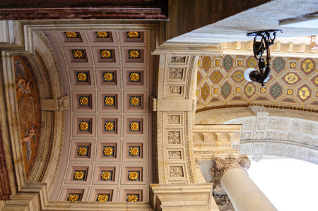 the gilding: View of one side of the main entrance pediment tympanum at Saint Stephens cathedral with beautiful ornate gilding Stock Photo