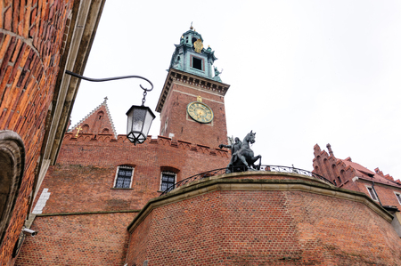 Tadeusz Kosciuszko bronze equestrian monument and Wawel cathedral clock tower Stock Photo